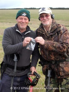 Nigel Holt and Mike Holland holding Stephen Petrunos' recovered dog tag.