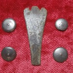 These center nipple buttons and trifid spoon handle are exciting finds, as they solidly date back to the 17th Century.