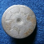 While most dug Tombac buttons are plain in appearance, this example I found from the mid-17th Century has a decorative design.